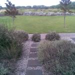 Immediately in front apartment 5 is a small tailored garden of pebbles & stepping stones.