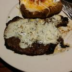 Ribeye with bleu cheese butter and loaded baked potato