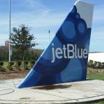 Sun clock with the Jetblue airplane tail...