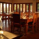Enjoy a 4 course lantern lit dinner in our yellow wood dining room.