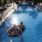 Us in the pool. Very long, good for laps. Frangipani trees everywhere. Lights that change colour