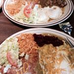 Huevos rancheros over easy w/cheese, beans, rice, green chili sauce, side of highly seasoned gro