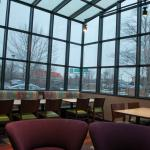 New glass-enclosed breakfast area with view of Interstate