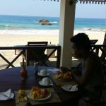 Enjoying breakfast at the beach front dining area of the guest house