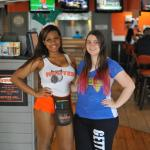 Myself with a waitress at Hooters of NW Freeway