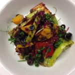Charred Leeks, Pepper & Halloumi with Black Olive Dressing & Baby Herbs.