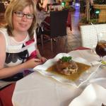My wife enjoying a slow baked shoulder of lamb notice the size of the portion enough for two