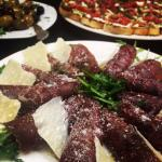 Bresaola rolled with arugula and aged grana padana cheese drizzled with white truffle oil