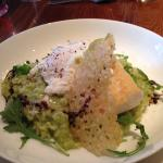 Main course smoked haddock loin on pea rissotto with Parmesan crisp