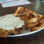 The chicken fried steak and onion rings are fixed and dredged in seasoned flour when you place y