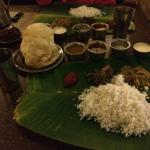 The vegetarian thali along with Mutton pepper fry, appam and buttermilk.