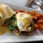 eggs benedict special. arugula and tomato