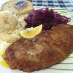 Schnitzel plate with red cabbage and german potato salad
