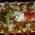 Nice presentation of shredded chicken nachos.  SPRAYGUN