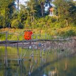 Three monks cross bamboo bridge