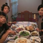 me , my younger brother and my mom having dinner