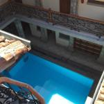 Private rooms overlooking the hostel's clean pool.