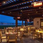 Oceana Coastal Kitchen Patio at night - Catamaran Resort Hotel and Spa