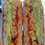 The Trotta Cado- Cheddar Cheese, Tomato, Avocado, Grilled Mac & Cheese.