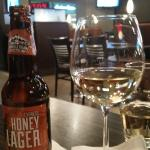 A cold Granville Island Honey Lager and a glass of Chardonnay, Houston  |  Edmonton Internationa