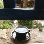 First Cup of Coffee on the Courtyard Window Sill