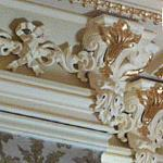 Exuberant Victorian ceiling trim in the Parlor.