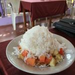 Palmira's famous fruit salad with curd, honey and coconut