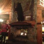 Fireplace, bear and Mountie