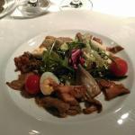 delicious salad with mushrooms, artichokes, quail eggs and mini tomatos