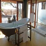 En-suite bathrooms include a large bath tub, both an indoor  & outdoor shower, plus twin vanity