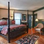 Room 2 on the first floor features a king bed and pumpkin pine floors