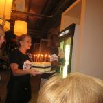 staff bring birthday cake