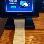 Nifty tabletop device allows diners to play games, read news, pay bill and print receipt