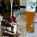 Black forest cake and a tall beer