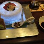 Four types of sashimi, yellow fin, yellow tail, salmon and abalone. Abalone liver, fresh wasabi