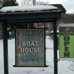Boathouse sign with the Over the Bar Bicyle Cafe sign on the right