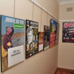 Posters of South African artists in the corridor