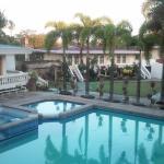 Pool and garden side of Village Inn Hotel