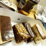 Tray of amazing slices. Baked cheesecake, Röcher slice, peanut butter and chocolate slice, Blond