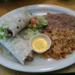 Chicken fajita wrap with beans and rice.