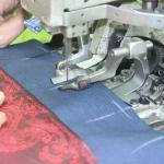 button holes stitching - one of the final steps in completing a custom made jacket
