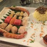 Fondue ds poissons : exelénte cuisine française au cœur de RAWAI , assiettes présenta table pour