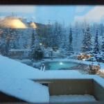 Snowy view out of our room over the hot tubs