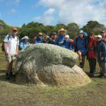Our group surrounding an ancient rock formation