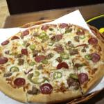 Huge meat pizza with Chili
