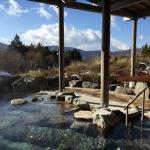 Lovely outdoor stone bath with view of Mt Fuji (hiding behind clouds)