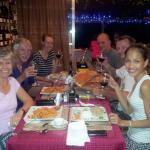 Taylor's family are having fun with there wine with there foods(pasta&pizza)
