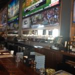 Lots ot draft beer taps and massive TVs