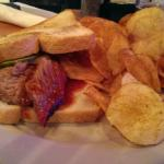 Brisket sandwich on sourdough bread, with BBQ chips