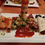 Sampler platter. Looks great and was very filling! Excellent value. Taquitos, nachos and soft t